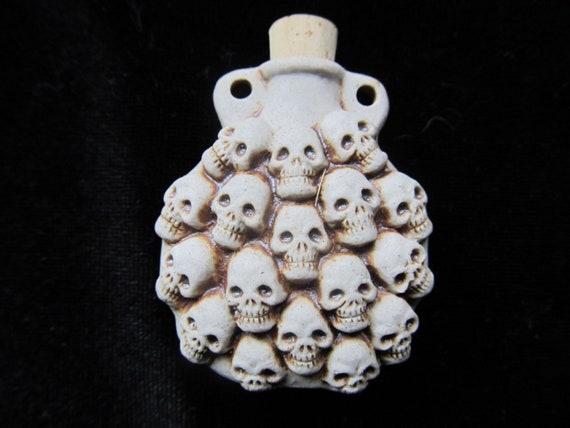 Stack of Skulls bottle pendant or necklace, Essential oil vessel,  Medicine bag, Memorial Jewelry for ashes