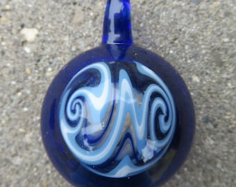 Hollow stash pendant - Cobalt blue glass with blue switch back spiral on front - You can hide stuff in it!