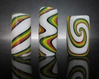 Full color #13 - Rasta on white,  Three styles and 6 sizes to choose from, Spiral - Wig wag - Twist, Hand Blown Glass Dread Lock Bead