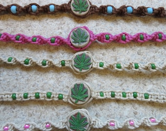 Hemp bracelet - Pot leaf - hand painted ceramic bead with glass accent beads. Hand tied in Bremerton, WA