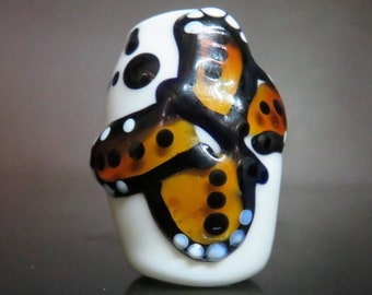 Butterfly on white, 8mm bead hole, Hand blown glass dread bead for dread locks and braids. #0552