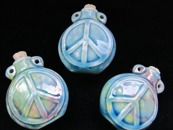 Ceramic Peace Sign Raku tiny bottle pendant or necklace, Essential oil vessel,  Medicine bag, Memorial Jewelry for ashes