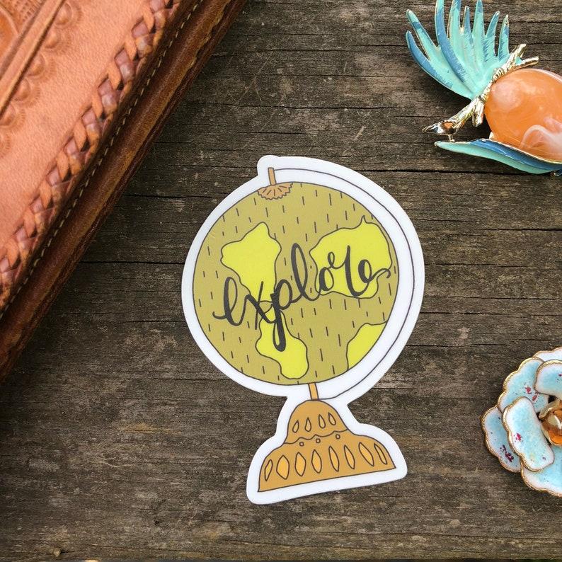 explore world globe travel vinyl die cut sticker image 0