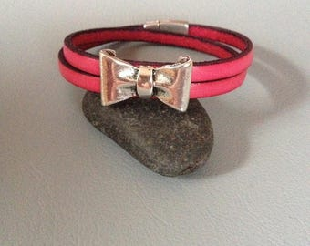 Bright pink leather, silver, bow bracelet double strand.