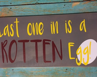 "Chicken coop sign. ""Last one in is a rotten egg."""
