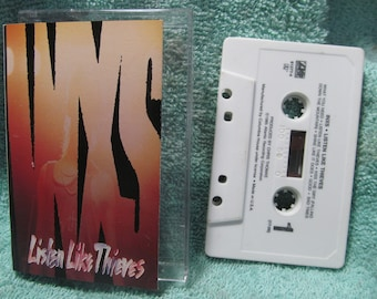 Inxs Listen Like Thieves Cassette Tape 1985 Atlantic, A4-81277 Cassette is very good, case is G, insert very is good, live recording