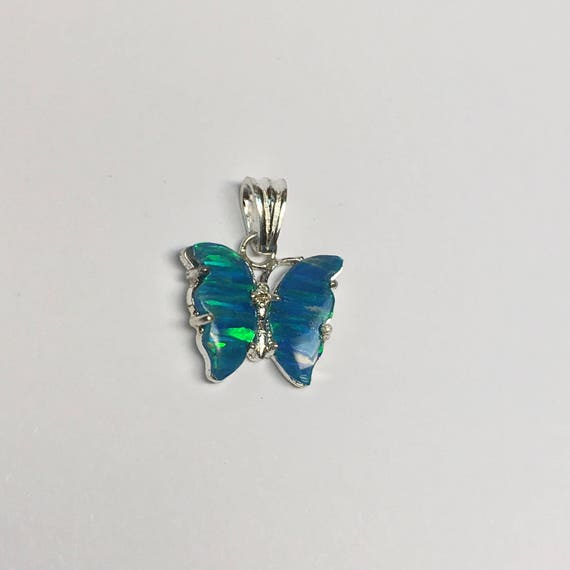 Opal butterfly pendant in sterling silver