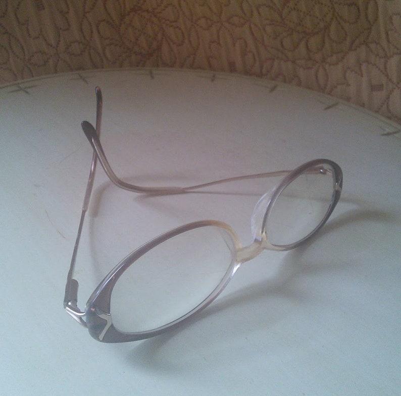 82a3fc670282 Catherine Deneuve eyeglasses 1990 s cinnamon and gold