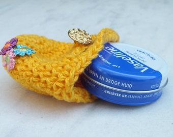 Vaseline lip balm with crocheted pouch, mini handbag, yellow, flowers.