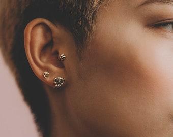 Phantom skull ear studs in 9 ct yellow gold