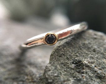Black diamond stacking ring with 18ct gold setting