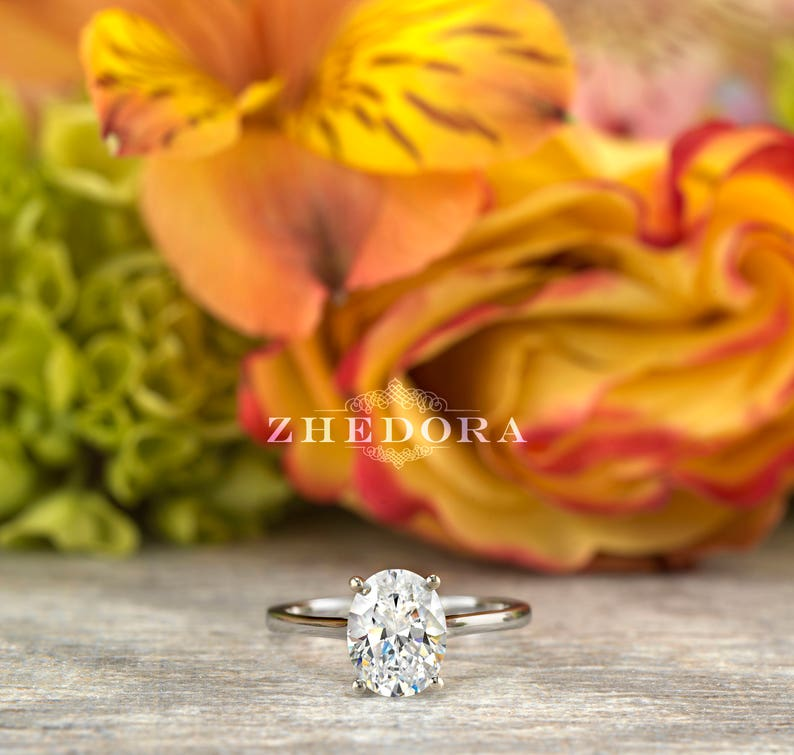 Forever One Oval Moissanite 2.0 CT Oval Engagement Ring in image 0