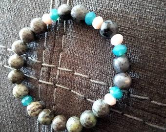 Gray and turquoise mala style bracelet. Grey semi-precious stones and turquoise glass stones