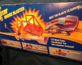 Hot Wheels Cap Bustin Bridge Blaster Set Complete with box