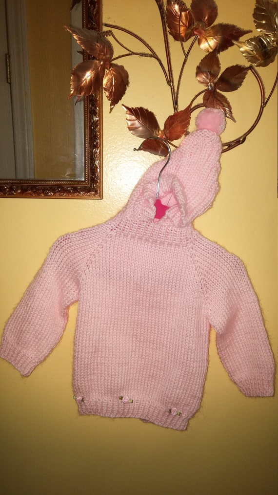 4c4401e33ffd Back-zippered baby sweater with hood