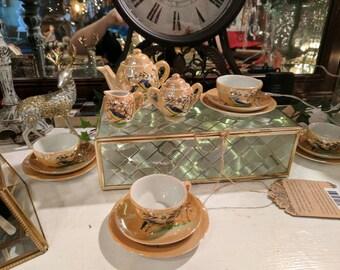 Lusterware child's tea set, blue bird and cherry blossoms