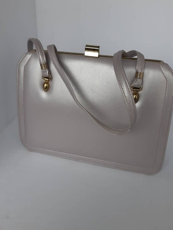 1960s Mauve Leather Top Handle Bag.