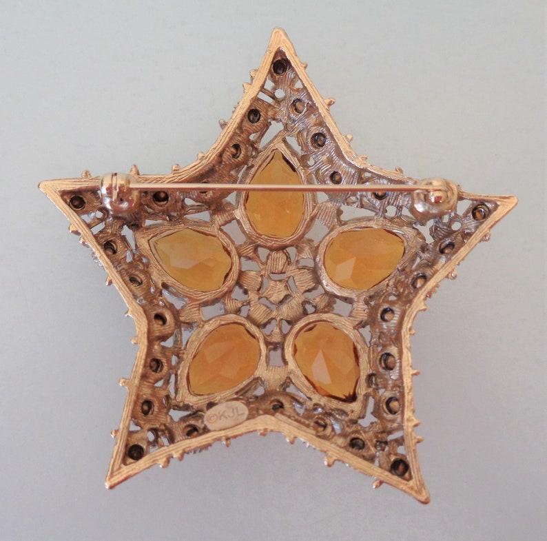 NIB. Open Work Signed Kenneth Jay Lane Citrine Orion Star Brooch Old Stock Authentic KJL