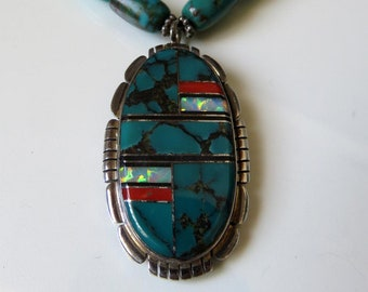 Vintage Sterling Silver Turquoise Coral Opal and Mother Of Pearl Navajo Necklace signed by the artisan Nila Cook Johnson