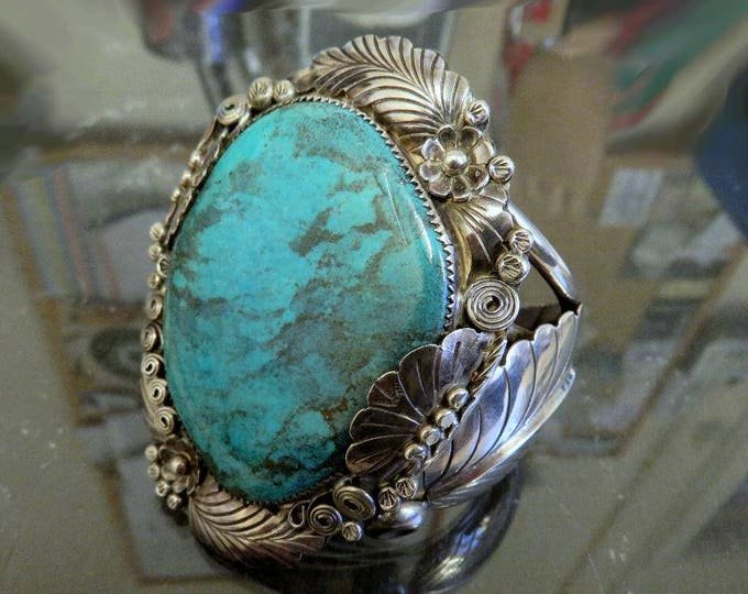 Featured listing image: Vintage Sterling Silver Navajo Turquoise Huge Cuff Bangle by artisan Jerry Roan