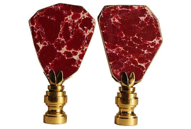 A Matching Pair Gilded Oxblood Sea Sediment Jasper Lamp Finials on Shiny Brass Bases