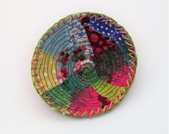 Embroidered recycled fabric brooch