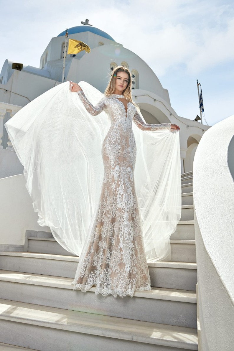 Lace mermaid wedding dress in bohemian style with long lace sleeves , short  lace train, deep v cut, closed transparent back with buttons