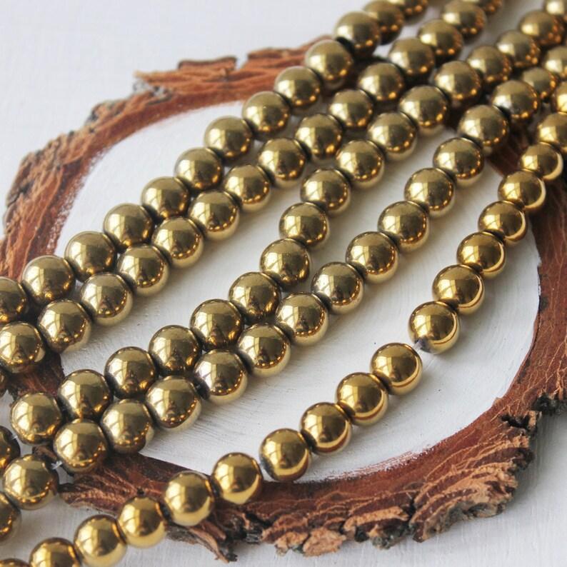 8mm hematite. gold hematite gemstone beads full strand 16 image 0