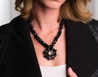 Vintage Rhinestone Brooch on barbell onyx necklace with rhinestone rondells