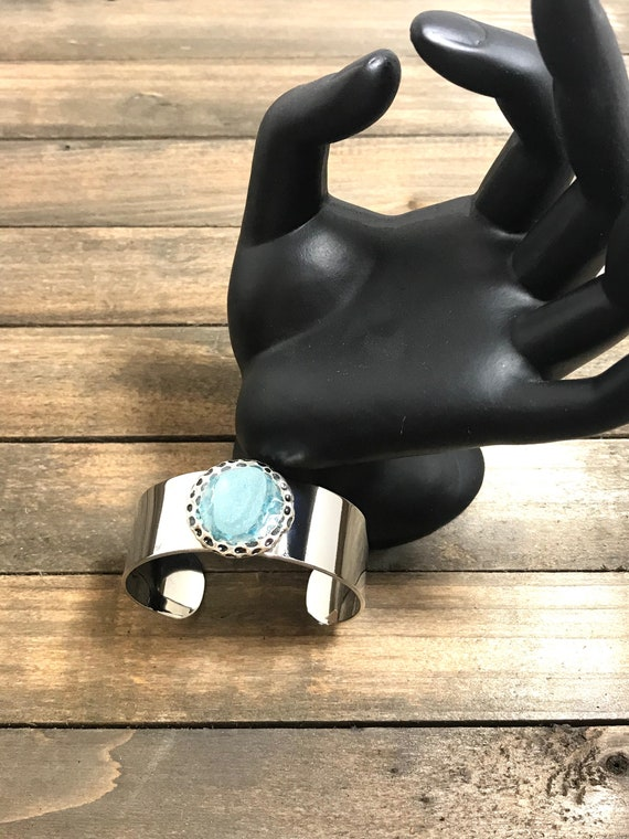 Shiny metal cuff bracelet with authentic sea glass embedded on resin