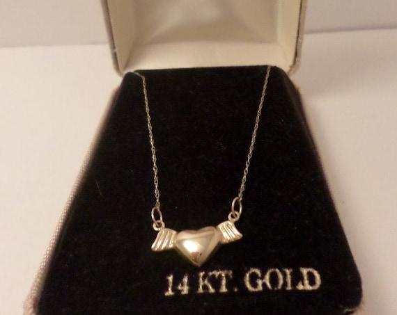 delicate vintage 14 kt gold 80-90's winged heart necklace