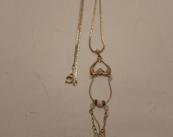 Vintage 80's gold tone chain with charm holder and dangles super 80s cool!