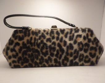 87b845958383 Vintage leopard faux fur purse from the 60's