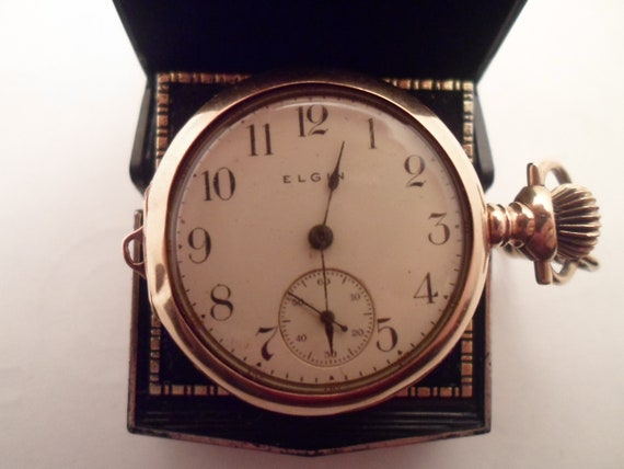 Antique 14k Solid Gold Elgin Ladies Elgin Pocket Watch or Pendant Watch Marked 14k on case Starburst Diamond or Crystal back Stone