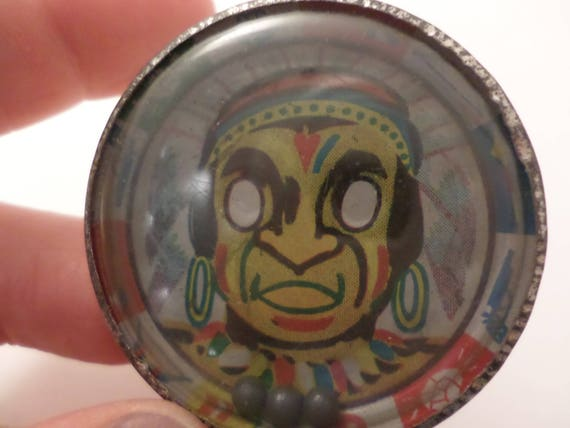 Cowboys and Indians small metal hand held vintage toy pinball dexterity eye game Indian litho