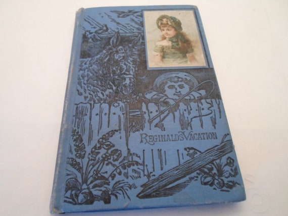 Antique 1890's Victorian Hard Cover Small Book Reginald's Vacation Beautiful Blue Engraved Front with Color Victorian Girl