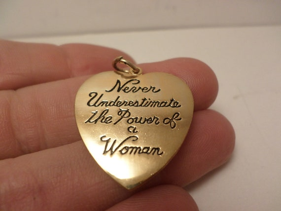 New old stock vintage Never Underestimate the Power of a Woman heart charm