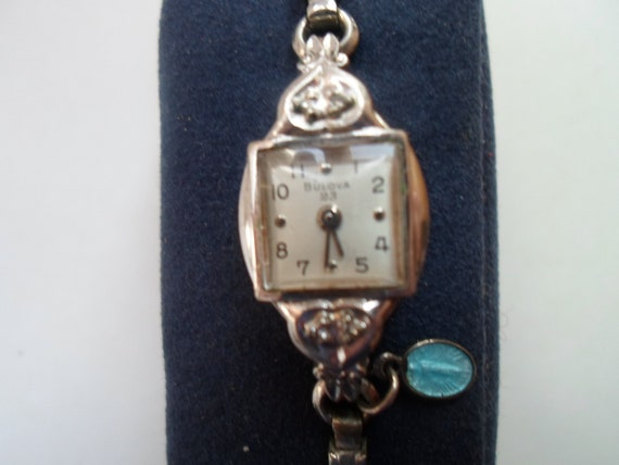 Vintage Bulova 23 White Rolled Gold Plate Diamonds Women's Wristwatch has Tiny Catholic Miraculous Medal Virgin Mary As Found