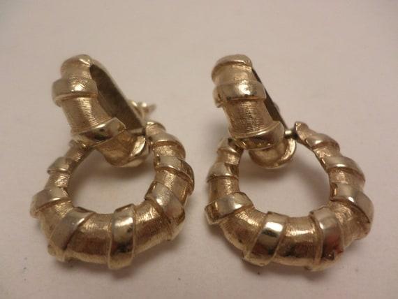 Vintage designer 80's earrings hoops in a hoop crown logo