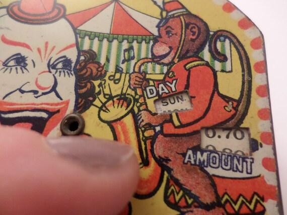 Antique circus metal pocket daily dime bank 5.00 clown monkey