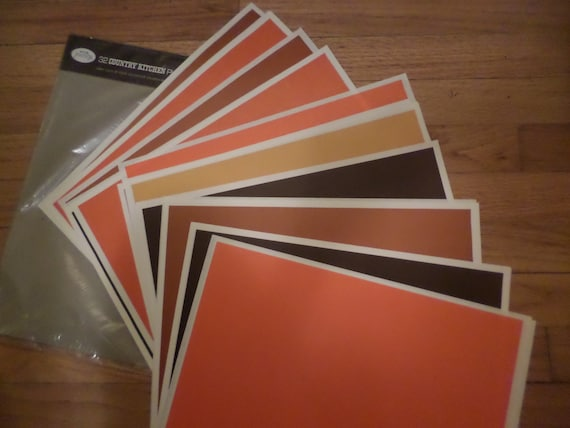 vintage 60's KVP purity paper placemats MOD brady bunch gold orange brown colors 31 pages PLACEMATS