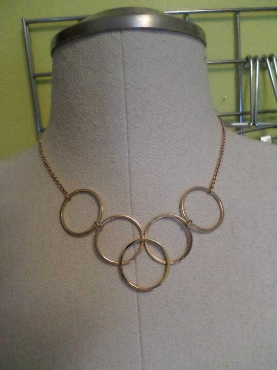 Vintage 70s mod circles AVON gold tone necklace