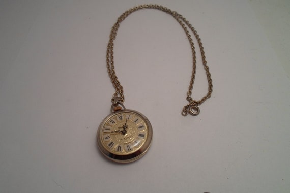 Vintage Mid Century Pendant Watch on Chain Necklace Enameled Roman Numerals Works Mechanical Embossed Case Holiday Ready