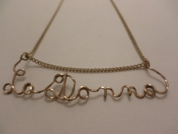 Vintage gold metal La Donna written necklace clever and chic!