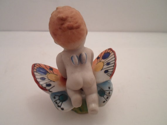 Antique Occupied Japan Bisque Nude Baby on Glazed Wing Butterfly Signed