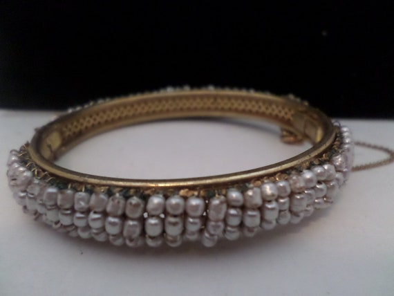 vintage 50's Miriam Haskell brass & seed pearl bead hinged bracelet