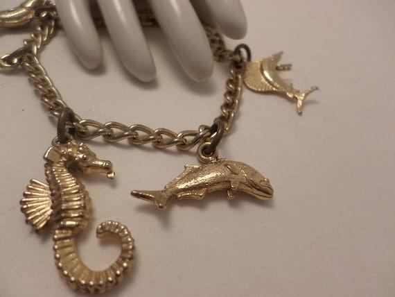 vintage fisherman charm bracelet, sea life, seahorse, gold tone 60's souvenir Florida
