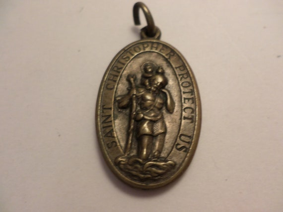 Vintage brass St Christopher St Raphael protect us pendant