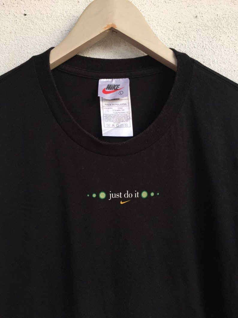 a95aab32b24fe Vintage Nike just do it Plain and simple move it 90s t shirt L