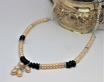 Pearl necklace, unique beaded necklace, garnet accents necklace, elegant accessory, delicate pearl and garnet necklace, unique gift for her